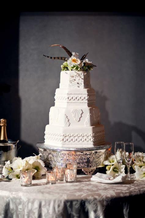 Elegant White Wedding Cake with Feather Cake Topper
