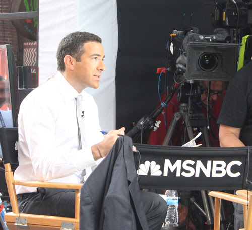 Ari Melber broadcasting live on MSNBC from East 4th Street