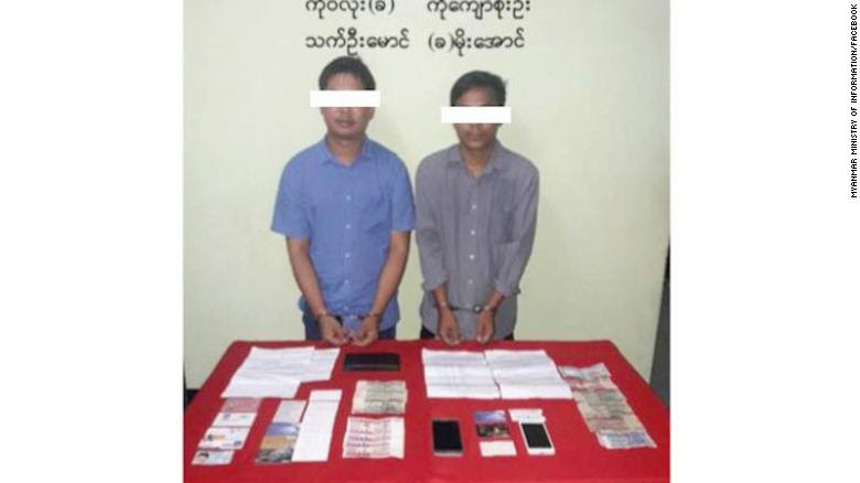 An altered image released by Myanmar's Ministry of Information shows two Reuters journalists, Wa Lone and Kyaw Soe Oo, in handcuffs.