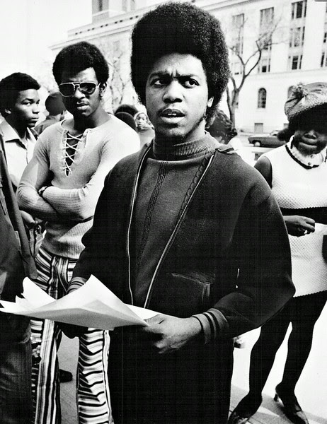 Description of  OCT 21 1971 - Virgil Robinson, Foreground, Led Blacks Demanding Action. Group assembled in front of federal courthouse to talk to newsmen. (Duane Howell/The Denver Post)