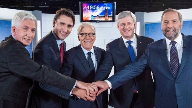 Left to right, Bloc Leader Gilles Duceppe, Liberal Leader Justin Trudeau, journalist Pierre Bruneau, Conservative Leader Stephen Harper and NDP Leader Tom Mulcair pose for photos before the start of the French-language debate on Friday.