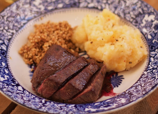 Pan-roasted loin of venison with redcurrant sauce