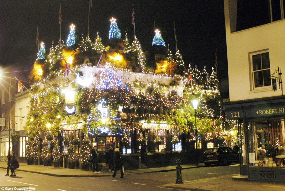 The Churchill Arms pub in West London covered in Christmas lights and decorations