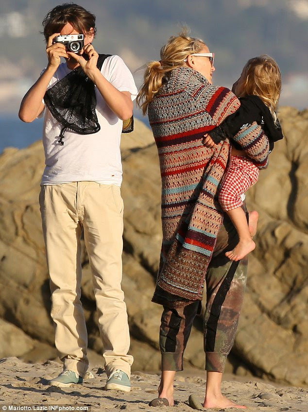 Picture perfect: While Kate cradled Bingham in her arms, Matt couldn't resist snapping pictures of his cute family