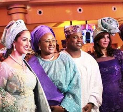 Nooshin, second from right at their traditional ceremony in Lagos in November, was declared bankrupt in 2014