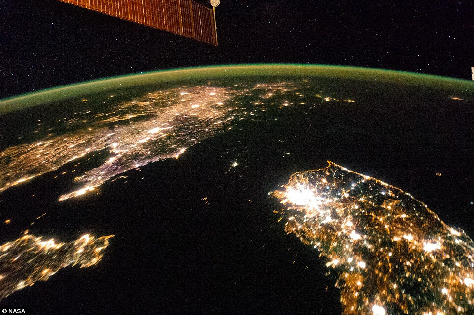 Blackout: The satellite images, taken from the International Space Station last month, shows North Korea as a swathe of dark ground between China in the north and South Korea