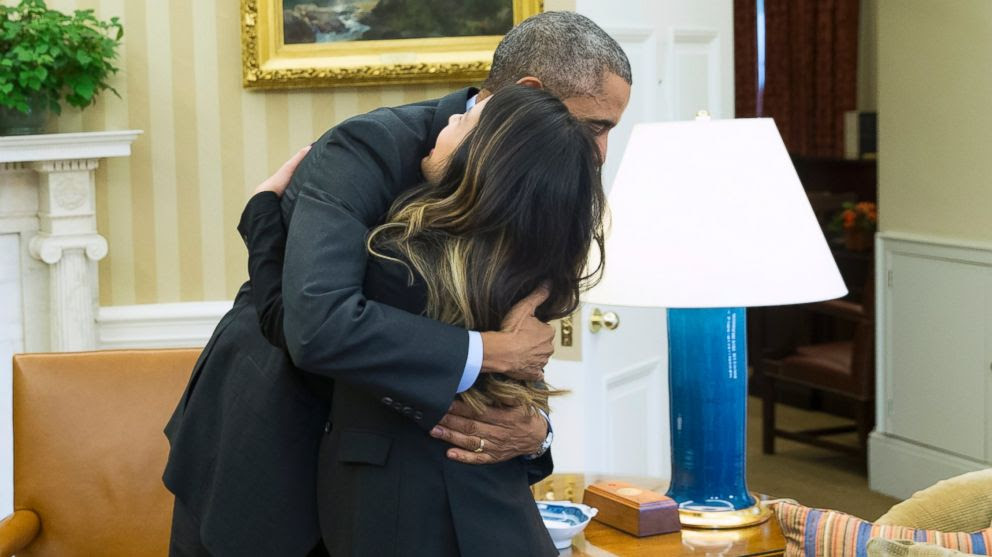 PHOTO: President Barack Obama hugs Ebola survivor Nina Pham in the Oval Office of the White House in Washington, D.C. on Oct. 24, 2014.