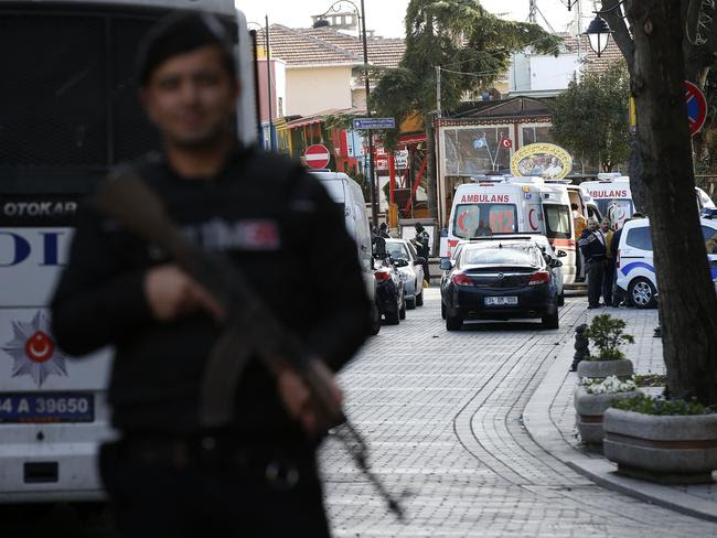 Investigation ... policemen secure the historic Sultanahmet district, as ambulances arrive. Picture: AP