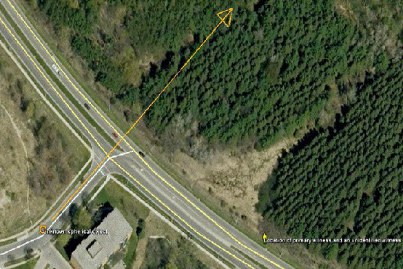 Direction traveled by spherical object in relation to the witness on the highway.