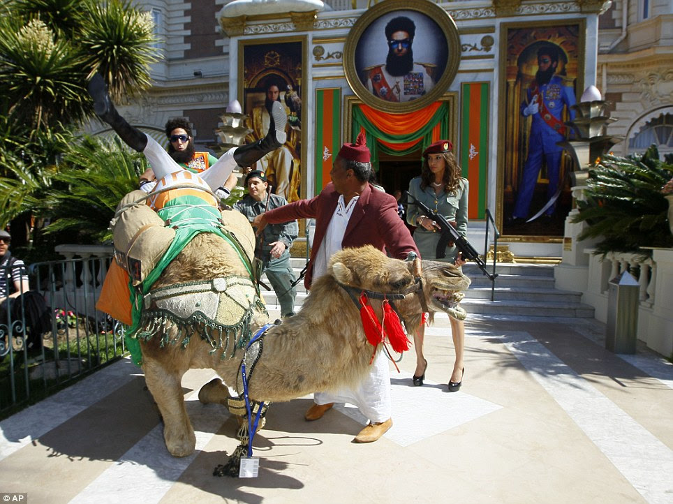 Elegant dismount: In typical hilarious form, Cohen made his way off the camel and into the hotel