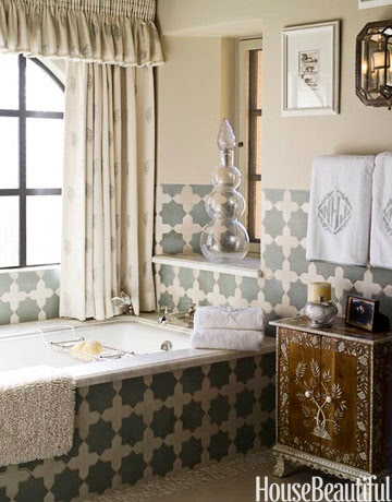 Designer Cathy Kincaid used Farrow & Ball's Old White paint on the walls has the same muted tone as Moroccan Cross and Star tiles by Ann Sacks. Curtains are Cowtan & Tout's Irina Sheer in Sky and Ivory. Indian inlaid cabinet from John Rosselli.