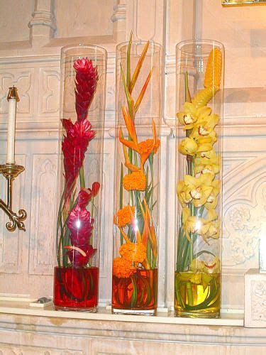Ginger, Heliconia, and Orchid centerpieces & it could keep