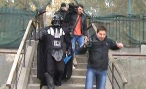 Phantom Menaces: The evil visitor heads to his destination accompanied by cameramen