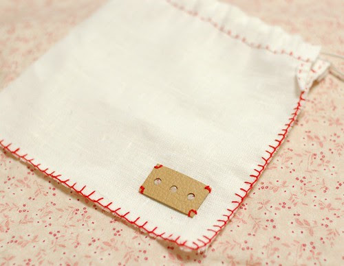 Linen pouch with a leather tag