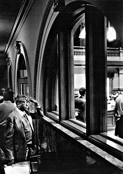 Description of  MAR 31 1978 - Jim Reynolds, Director of the Division of Civil Rights, waits for the House Caucus on Regulatory agencies to begin. (Ernie Leyba/The Denver Post)