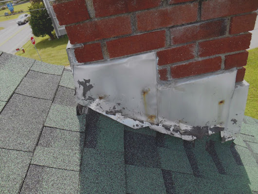 Missing or damaged chimney flashing - Chicago IL - Aelite Chimney