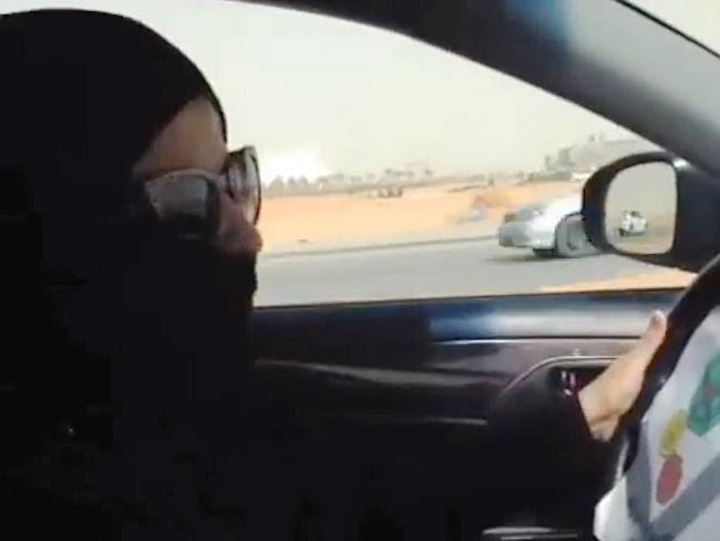 A Saudi woman drives a vehicle in Riyadh, Saudi Arabia.