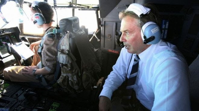 Tony Blair in a helicopter in Iraq in 2007
