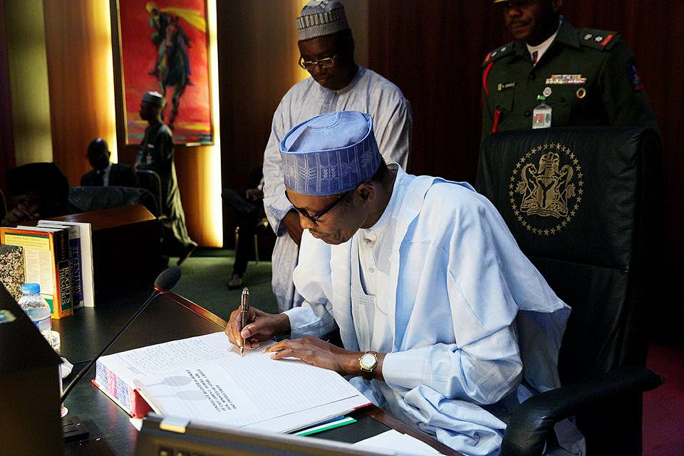 Image result for buhari signing