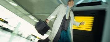 Photo: Man running through airport
