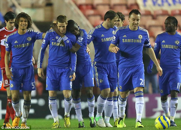 You have it: Ramires hugs Torres as Chelsea celebrate taking the lead