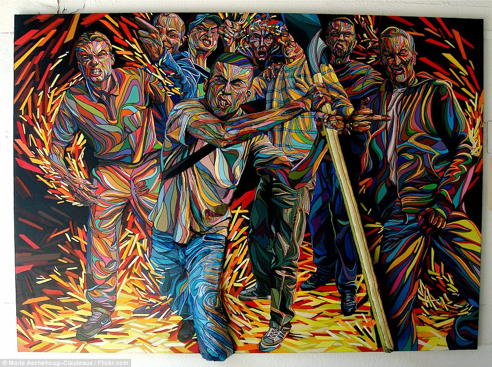 Wild bunch: This snarling group of men, portrayed in vivid technicolour, appear to jump out of the canvas in another of Shaka's pieces