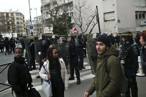 French police clash with youths at protest rally, arrest eight
