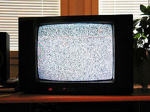 An analog TV showing noise, on a channel with ...