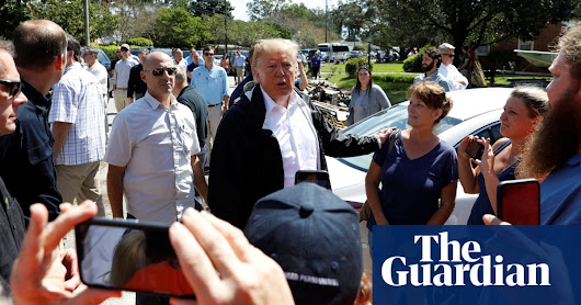 Trump pledges '100%' support during post-Florence visit to North Carolina | World news | The Guardian