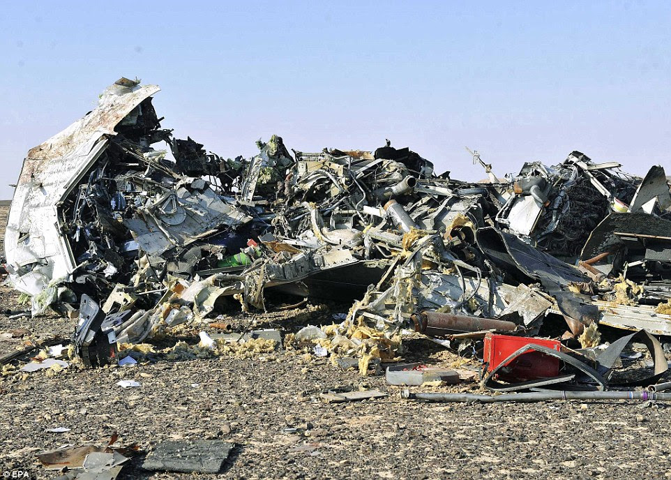 Horrific: This is one of the first images of the mangled wreckage of the Russian passenger jet that crashed this morning, killing 224 people