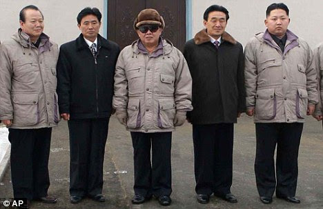 Firm grip: North Korean leader Kim Jong Il and his heir apparent Kim Jong Un, far right. The communist country has strict rules on allowed products
