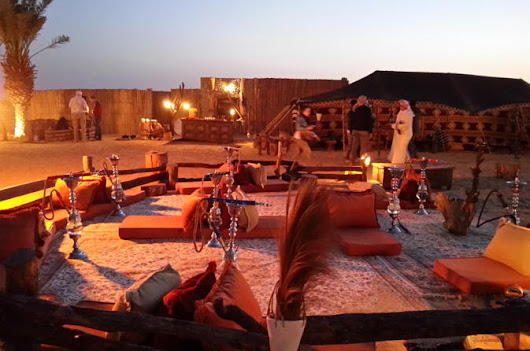 Luxury Desert Experience: Dinner and Emirati Activities with Vintage Land Rover Transport from Dubai