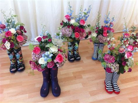 Flowers in wellies for this marquee wedding!   Wedding