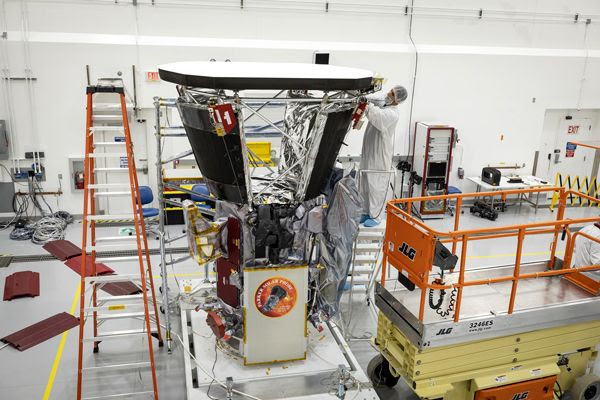 Engineers install the Parker Solar Probe's heat shield inside the Astrotech Space Operations facility in Titusville, Florida...on June 27, 2018.