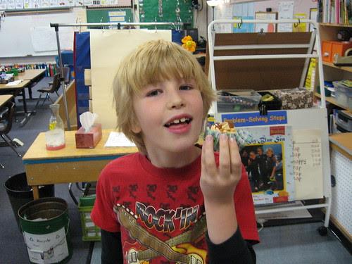 The Birthday Boy enjoys his cupcake