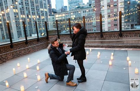Wedding proposal on a private rooftop with Empire State