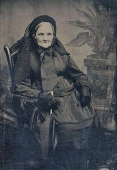 Elderly lady in mourning, Tintype, circa 1875.