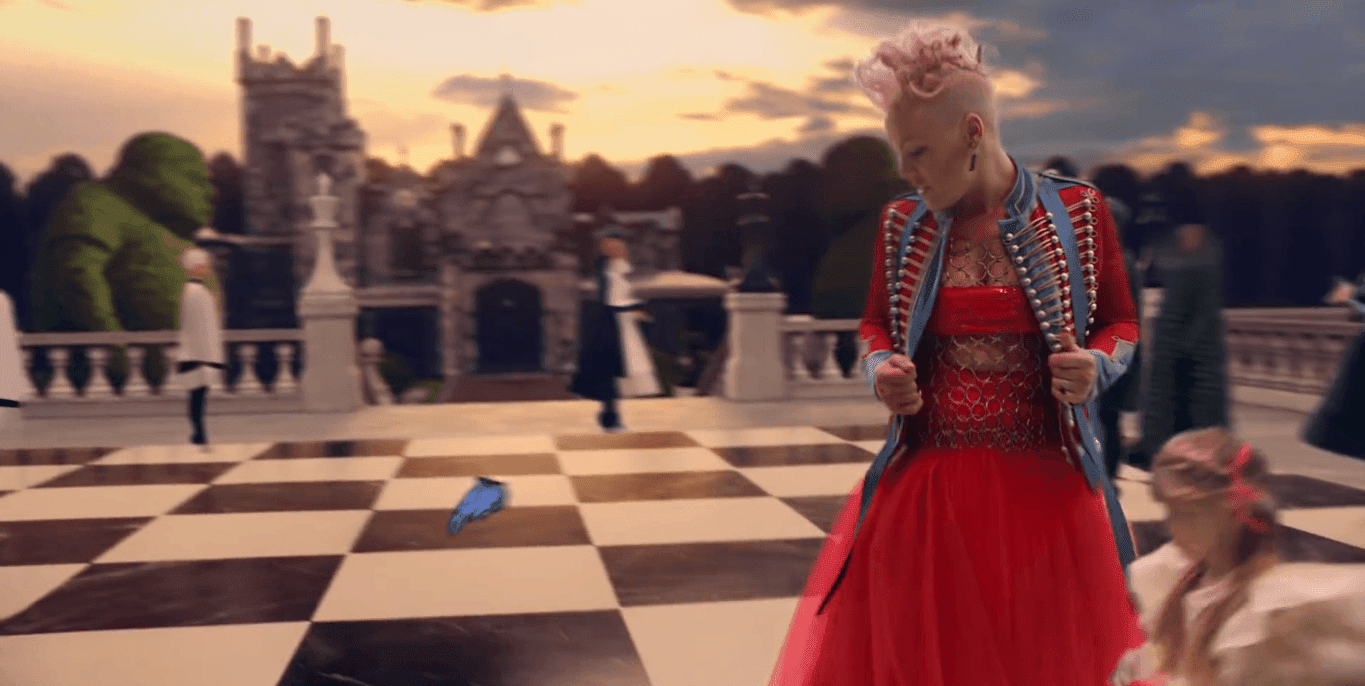 In Wonderland, Pink finds herself on a chessboard while her core persona (the little girl) keeps running after the butterfly (following the programming script).