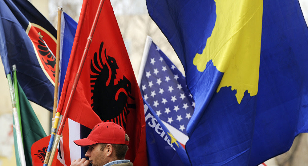 A Kosovo Albanian man sells flags in Pristina on February 16, 2011 in preparation for the third anniversary of Kosovo's declaration of independence