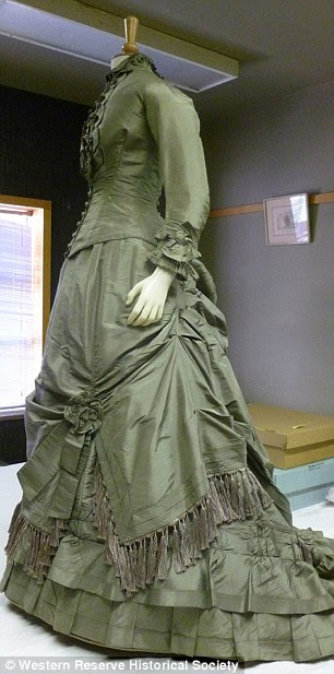 1870's green gown with asymmetrical skirt and fringe