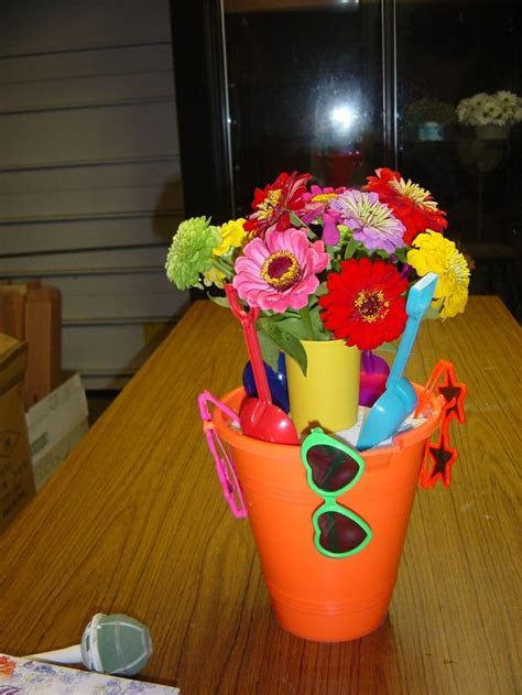 Beach party? Simple bucket centerpiece with sunglasses
