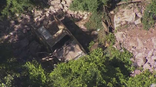 Pickup truck goes over 30-foot cliff near Superior