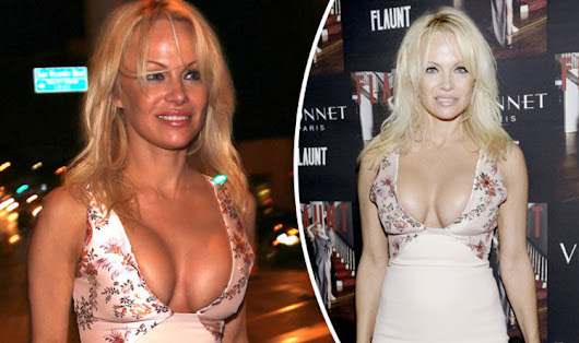 Pamela Anderson flashes MAJOR bust as she risks pouring out of sexy plunging frock