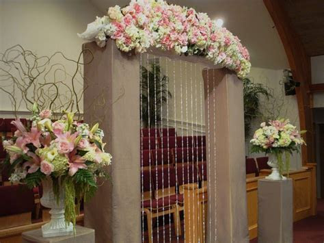 pink wedding flowers ceremony flowers church indoor decor
