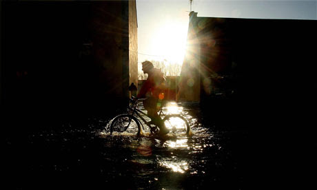 Cop15 climate change: cyclist in Ballinasloe, County Galway, Cumbria  during floods