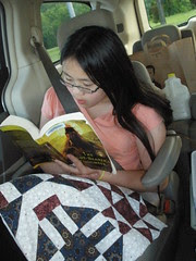 Sophia Reading in Loaner Minivan