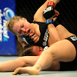 Ronda Rousey and Liz Carmouche deliver in main event, scoring one for female athletes everywhere