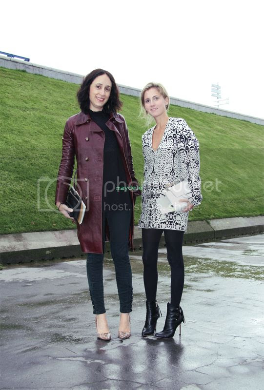 Nicole Phelps wearing Emilio Pucci trench with Marina Larroudé wearing Gianvito Rossi shoes and carrying Reed Krakoff minibag