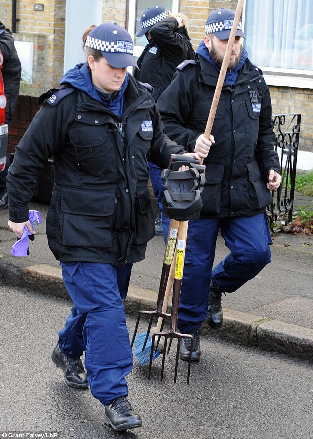 Dig: This morning two officers were seen carrying digging equipment into the garden of the home before the discovery was made