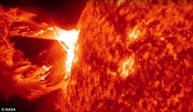 Devastating space storms could wipe swipe Earth at any time and humans will only have fifteen minutes to prepare, a scientist has warned. Pictured is a solar flare and coronal mass ejection